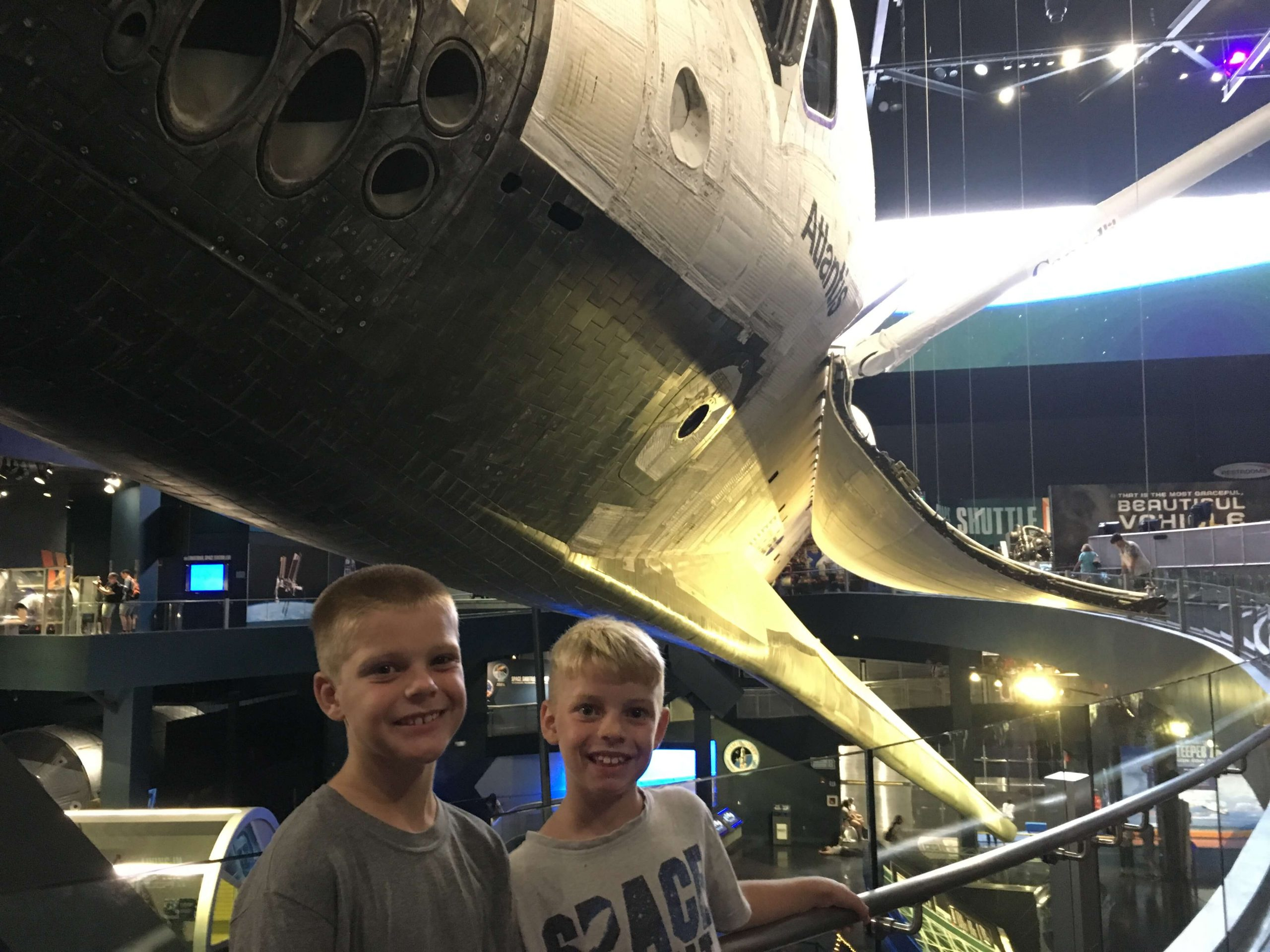Miles and Gabe in front of Shuttle Atlantis